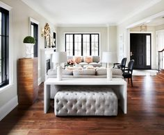 Black and white living room with wood floors and gray accents.