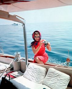 No one could ride a boat in such style as Jackie O #jetsettercurator