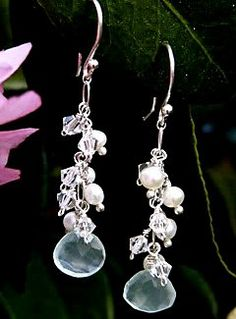 """#E004    Each Swarovski crystal and freshwater pearl is individually wire-wrapped and hung from sterling silver wire to create this """"grape cluster"""" earring. Embellished with light blue Quartz crystals. **CUSTOMIZABLE **Matching necklace and bracelet available"""