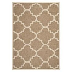 Showcasing a chic quatrefoil motif in a neutral palette, this indoor/outdoor rug infuses your patio or three season porch with on-trend appeal.      Product: RugConstruction Material: PolypropyleneColor: BrownFeatures:  Made in TurkeyPower-loomedSuitable for indoor and outdoor use Note: Please be aware that actual colors may vary from those shown on your screen. Accent rugs may also not show the entire pattern that the corresponding area rugs have.Cleaning and Care: Sweep, vacuum or rinse of...