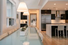 Contemporary kitchen, hard wood floors, glass table top, white countertops, leather stools, white, lighting, cityhomeCOLLECTIVE