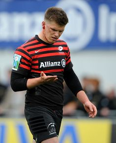Owen Farrell of Saracens checks the cut on his ear during the Aviva Premiership Semi Final match between Saracens and Northampton Saints at Allianz Park on May 12, 2013 in London, England.