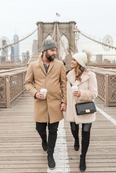 Chic & Cozy His and Hers outfits by blogger, Jenn of Haute Off The Rack, faux fur coat, Koral lustrous leggings, metallic booties, over the knee boots, camel coat, his & hers winter style, women's fashion, pom beanie, faux leather leggings, engagement photos, Dumbo, Brooklyn Bridge photos, winter couples session