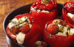 Grandma filled these sweet red bell peppers to the brim with melting mozzarella, cherry tomatoes and pesto, and then oven-roasted them to perfection.