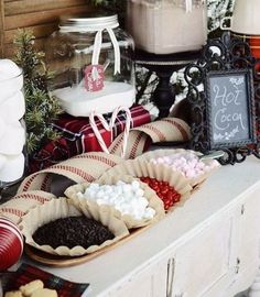 What's the easiest way to keep your guests warm on your winter big day? Besides blankets, it's an s'mores or a hot chocolate bar (or both in one). How can you design one? Just put lots of mugs, hot chocolate, various cookies, peppermint