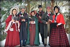 Christmas caroling in 1850's Dickens costumes.