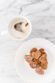 Heart French toast bites make the perfect Valentine's breakfast!  Adorable heart shaped toast bites with rich vanilla flavors and a cinnamon and sugar topping are just the thing for your sweeties. Get the quick and easy Valentines recipe here!