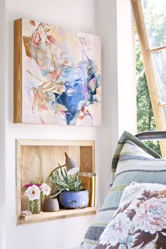 Instead of finger paintings and stick drawings, try watercolor artwork. Emily's own handiwork adds a fitting dose of flora and fauna to the serene setting.