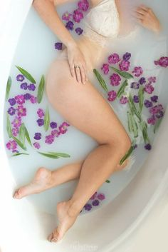 Sexy Milk bath with purple flowers, legs for days #boudoirphotography,