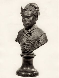 A European noble man of medieval Venice, Italy.  Anonymous Sculptor (Venice) Portrait Bust of a Man Italy (early 16th Century) Polychromed Bronze, 27.9 cm. (H) [Bust of a black man wearing a doublet, a soft cap with a tassle, and...