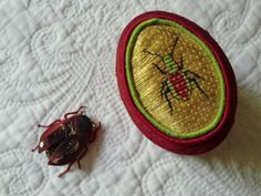 Another beetle and box inspired by Heide Jenkins. The box features a bombadier beetle done in or nue.