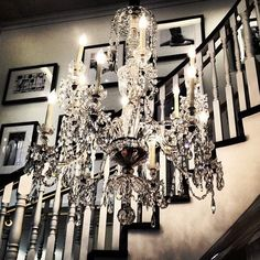 Have a chandelier at your wedding! Then, have it in your bathroom, over your table, or in the foyer of your house! Love the pictures along the stairs Home Interior Design, Interior And Exterior, Interior Decorating, Decorating Ideas, Decor Ideas, Architecture Design, Chandelier Lighting, Chandelier Staircase, Foyer Staircase