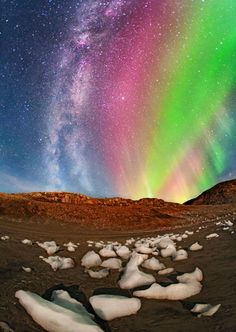 A view of the Milky Way and the Northern Lights at the Qaleralit Glacier in Greenland
