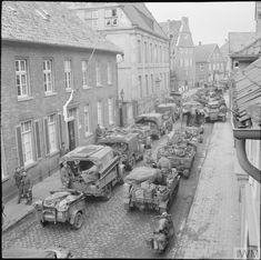 Infantry of Division clearing out snipers in the town of Lingen, 7 April