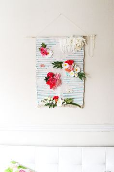 "The Pinterest 100: Home; Woven Wall Decor. ""A major trend in both DIY and Home Decor is woven wall hangings. They add a unique mix of color and pattern to a room without being overwhelming. Since they are handmade, they make great gifts as well!"" said Pinner Marjorie (https://www.pinterest.com/thekipiblog/)"
