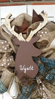 Deer nursery wreath with birchbark antlers.  https://www.etsy.com/listing/218777993/deer-nursery-decor-burlap-deer-wreath
