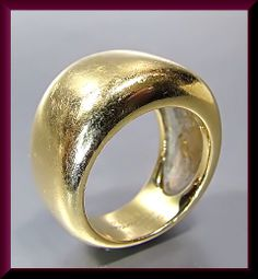 18K YELLOW GOLD VINTAGE CARTIER DOMED RING Set in 18k yellow gold, this vintage domed Cartier ring exhibits simple elegance creating splendor on your finger. It is signed and numbered by Cartier and comes with papers. R 417M