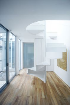 Ultra slim, free standing staircase made of perforated steel, inside a 46 sqm family house located in Tokyo, Japan, designed by Hiroyuki Shi...