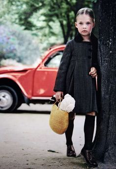Funeral perhaps?? Odd for a wee one to be in all-black but I love big coats and tall socks on little girls, so classic & cute!