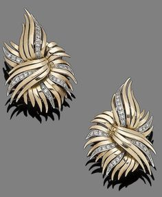 A pair of diamond-set spray earclips, circa 1945 Each stylised flowerhead with single-cut diamond highlights, diamonds approx. 0.60ct total, length 3.7cm