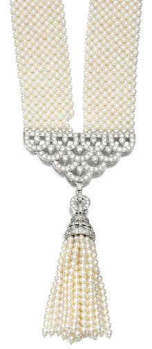 CULTURED PEARL AND DIAMOND SAUTOIR Composed of a woven mesh of cultured pearls, to a connection of open work scalloped design set with brilliant-cut diamonds, to a detachable tassel similarly set, length approximately 680mm, one cultured pearl deficient.