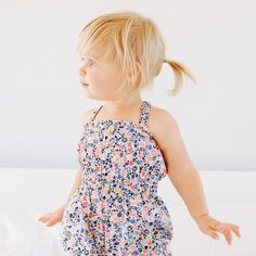 Floreale Smocked Romper | Floreale means floral in Italian. Bunches of flowers are all abloom on this pretty printed romper.