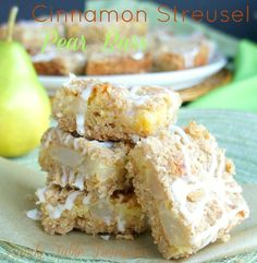 Cinnamon Streusel Pear Bars - Family Table Treasures These Cinnamon Streusel Pear Bars combine a cinnamon oatmeal crust, pear and cinnamon chip filling and a cinnamon oatmeal crumb topping. Finally icing is drizzled on top to make them even more scrumptious!