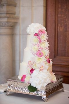 Wedding cake with pink flowers. Summer Wedding at Turner Hills - BKB & CO. | Boston Wedding Photography and Video Studio