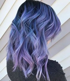 Balayage blue to purple amazingness! Stunning bright hair color and love how the waves show all the different shades and hues. Tres brilliant!