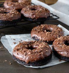 Triple Chocolate Cake Doughnuts. Chocolate cake + semi-sweet chocolate topping + dark chocolate shavings. *swoon*