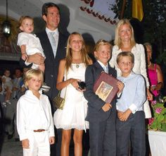 After the ceremony.  Pavlos and Marie-Chantal gather with their complete brood after the christening of their youngest child, Aristidis-Stavros.  What a good looking family!