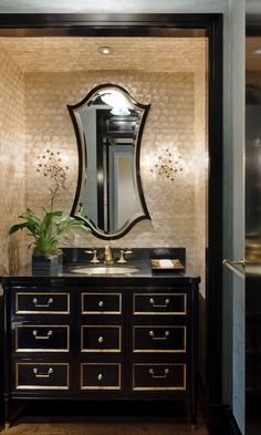 This bathroom is so sophisticated. Love the mirror in particular! From House of Turquoise. Black And Gold Bathroom, Black Bath, Sweet Home, Powder Room Design, House Of Turquoise, Turquoise Kitchen, Beautiful Bathrooms, Glamorous Bathroom, Bathroom Inspiration