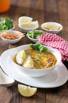 Khow Suey is soup meal bowl inspired from Burmese noodle dish Ohn Khauk swe , soup is rich lots of veggies and noodles cooked in coconut curry based soup.
