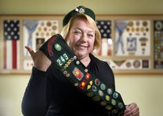 """Girl Scouts at 100: Still 'courageous and strong' - The Orange County Register. Donning her Cadette beret and holding up her badge sash, Janet Lee Krochman (54) shared some memories of being a military """"brat"""" and how Girl Scouting helped with all the moving.  She spent the longest amount of time in Girl Scouting while living in Hawaii."""