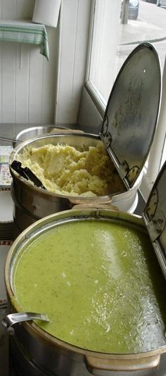 Pictured here, mash(ed potato) and liquor (parsley sauce) in a typical pie and mash shop setup.