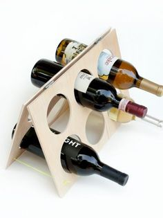 DIY Network has instructions on how to make a simple rack to hold wine bottles.