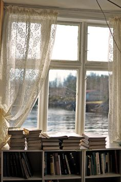 That view! I would replace the bookshelf with a bed though, so I could look out the window and read all day