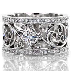 A beautiful vintage inspired ring. Lauren from Knox Jewelers contains a fluid curl pattern that embraces the center princess cut diamond. The design is framed with micro pave diamonds that compliment the piece.