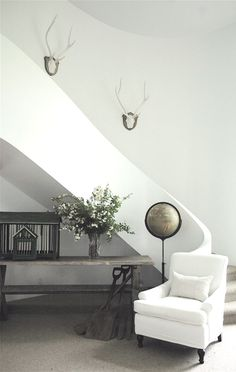 winding stairwell + minimal rustic decor  by Kathleen Clements Design