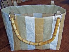 Fused Grocery Bag Purse;     by Stacy Gates;  This purse was made with different color tan/beige plastic bags. The bags were fused together, cut into strips and sewn together like fabric. Kind of reminds me of the patchwork leather items of the 70s. I guess they now call it pleather.