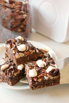 These gooey Mississippi Mud Bars are full of chocolate flavor and loads of texture thanks to a heaping helping of marshmallow, pecans and coconut flakes drowned in fudgy topping. It's one muddy mess you'll never mind having in your kitchen!