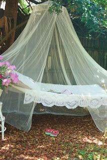 Hammock and mosquito netting hung on trees in back yard for a relaxing retreat. Beautiful. I need this!
