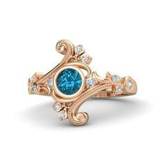 The Flamenco Ring customized in London blue topaz, diamond and rose gold