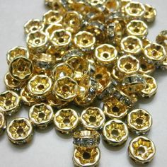 6/8/10mm Gold Plated 100pcs Wholesale Clear Crystal Rhinestone Rondelle Spacer Loose Bead Charm Findings 3 Sizes. $5.91, via Etsy.