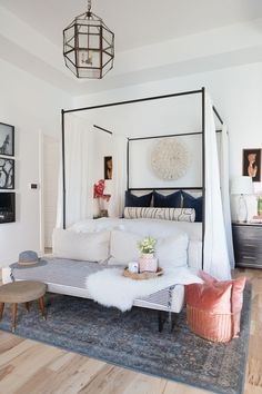How to Use a Juju Hat in Home Decor navy modern master bedroom navy black and white home decor juju hat above bed juju hat bedroom decor black nigh stands marble lamps gold base sofa at the end of bed - September 28 2019 at Modern Master Bedroom, Master Bedroom Design, Trendy Bedroom, Home Decor Bedroom, Bedroom Ideas, Bedroom Black, Bedroom Photos, Bedroom Furniture, Contemporary Bedroom