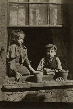 Spitalfields nippers: Boy and girl on window ledge