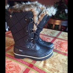 Black Faux Fur Boots Waterproof and Thinsulate.. Slightly used. Coming from a Non Smoking Household Skechers Shoes