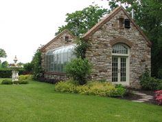 stone & glass greenhouse