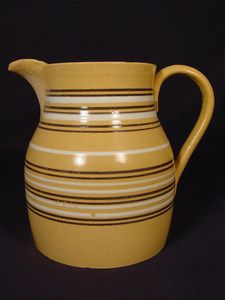 This is an attractive large black and white band pitcher. The pitcher is in remarkably good condition with only a small chip on the inside of the foot rim which doesn't show or detract. Antique Stoneware, Stoneware Crocks, Vintage Bowls, Vintage Dishes, Vintage Pottery, Vintage Ceramic, Canned Butter, Milk Cans, Pottery Designs