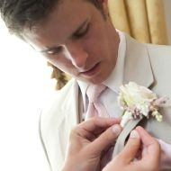 Possibly having anemones instead of roses for the fathers/groomsmen. Pictured are boutonnieres of ivory spray roses and pale pink astilbe wrapped in raffia with the stems showing
